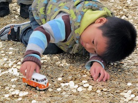 kid playing on coins